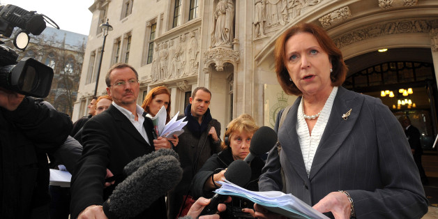 Angela Knight the Chief Executive of the British Bankers Association reads a statement outside the Supreme Court in Westminster central London, after High Street banks won their appeal over unauthorised overdraft charges.