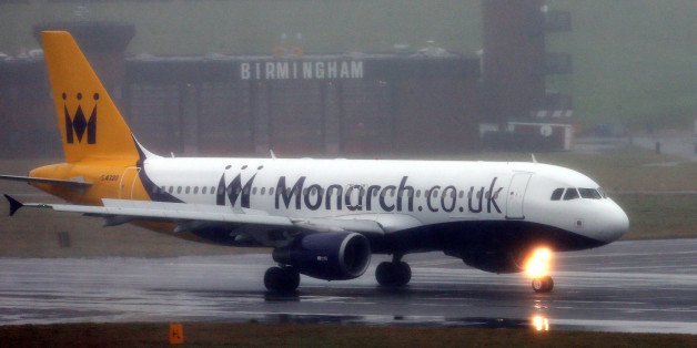 A Monarch Airways plane lands at a wet Birmingham Airport today as the aircraft maintenance division of the travel group has announced plans to build a new facility at Birmingham Airport, creating up to 300 jobs.