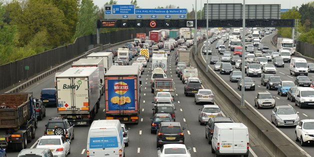 Motorists queue in heavy traffic on the M25 between junction 12 and 13 as the Easter getaway starts