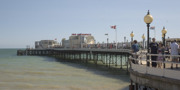 ENGLAND West Sussex Worthing People walking along the promenade deck on Worthing Pier