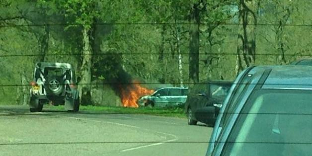 A mother and her two children had to abandon their car as it overheated and caught fire at Longleat Safari Park