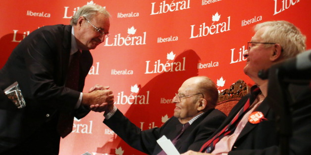 Former prime minister Paul Martin (left) shakes hands with former Liberal cabinet minister Herb Gray (centre) as former prime minister John Turner (right) looks on during a tribute in Ottawa, Monday November 19, 2012 to Gray's 50 years of public service. (THE CANADIAN PRESS/Fred Chartrand)