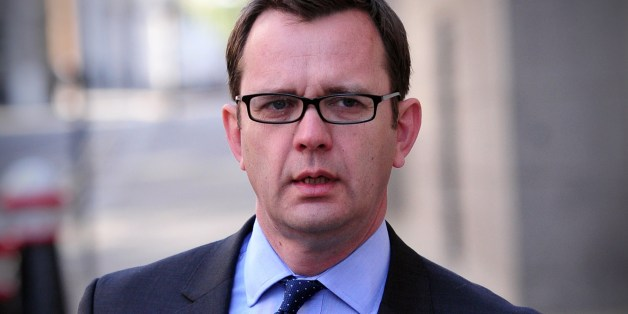 Former News of the World editor and Downing Street communications chief Andy Coulson arrives at the Old Bailey court in central London on April 16, 2014 as he continues to give evidence in the phone-hacking trial. Coulson is among seven defendents on trial over alleged phone hacking at the defunct News of the World newspaper and related charges. All defendents deny the charges.  AFP PHOTO / CARL COURT        (Photo credit should read CARL COURT/AFP/Getty Images)
