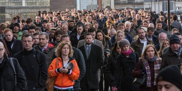Crowds of commuters on London Bridge this morning.