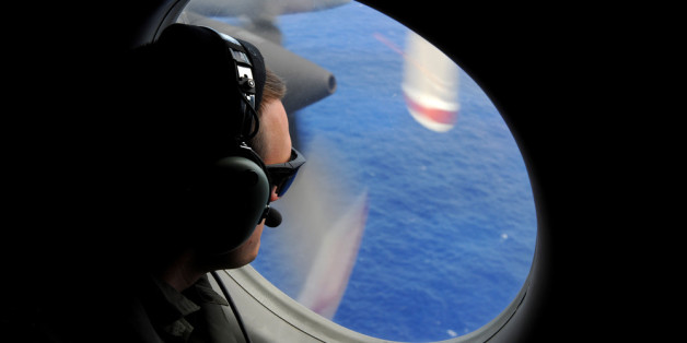 IN FLIGHT - APRIL 11: A crew member of a Royal New Zealand Airforce (RNZAF) P-3K2-Orion aircraft helps to look for objects during the search for missing Malaysia Airlines flight MH370 in flight over the Indian Ocean on April 13, 2014 off the coast of Perth, Australia. Search and rescue officials in Australia are confident they know the approximate position of the black box recorders from missing Malaysia Airlines Flight MH370, Australian Prime Minister Tony Abbott said on Friday. At the same tim