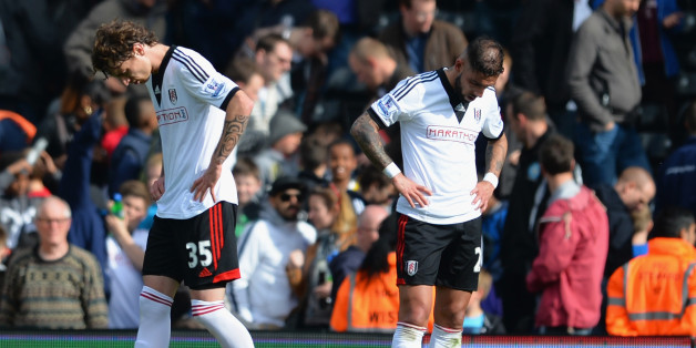 LONDON, ENGLAND - APRIL 26:  Goalscorers Fernando Amorebieta and Ashkan Dejagah of Fulham look dejected at the final whistle during the Barclays Premier League match bewteen Fulham and Hull City at Craven Cottage on April 26, 2014 in London, England.  (Photo by Christopher Lee/Getty Images)