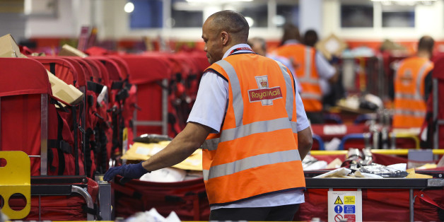 A Royal Mail Plc employee sorts parcels into red delivery destination trolleys at the company's Mount Pleasant postal sorting office in London, U.K., on Tuesday, Feb. 11, 2014. Royal Mail, the U.K. postal service that sold shares in an initial public offering last year, said like-for-like sales gained 2 percent in the first nine months of the year boosted by parcel deliveries. Photographer: Chris Ratcliffe/Bloomberg via Getty Images