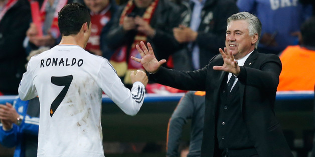 MUNICH, GERMANY - APRIL 29:  Cristiano Ronaldo (L) of Real Madrid celebrates after scoring his team's fourth goal with his head coach Carlo Ancelotti during the UEFA Champions League semi-final second leg match between FC Bayern Muenchen and Real Madrid at Allianz Arena on April 29, 2014 in Munich, Germany.  (Photo by Boris Streubel/Getty Images)