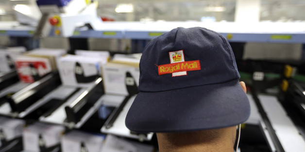 A logo sits on the cap of a Royal Mail Plc employee as he collects pre-sorted letters for delivery from a sorting machine at the company's Mount Pleasant postal sorting office in London, U.K., on Tuesday, Feb. 11, 2014. Royal Mail, the U.K. postal service that sold shares in an initial public offering last year, said like-for-like sales gained 2 percent in the first nine months of the year boosted by parcel deliveries. Photographer: Chris Ratcliffe/Bloomberg via Getty Images