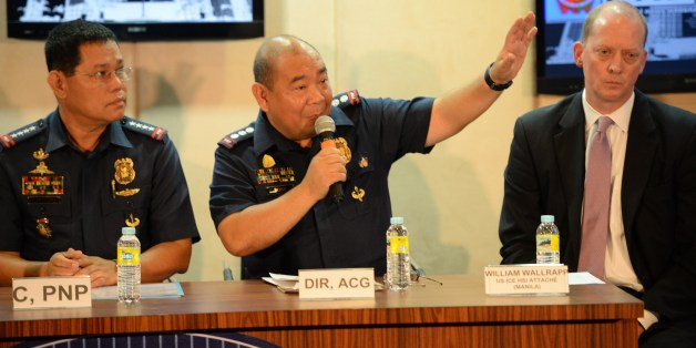 Gilbert Sosa (C), Philippine police chief of cyber crime division