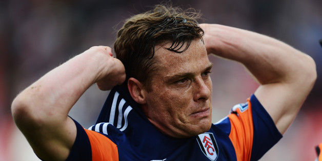 STOKE ON TRENT, ENGLAND - MAY 03:  Scott Parker of Fulham reacts as his side are relegated following their defeat in the Barclays Premier League match between Stoke City and Fulham at the Britannia Stadium on May 3, 2014 in Stoke on Trent, England.  (Photo by Jamie McDonald/Getty Images)