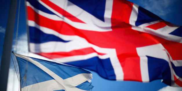 GLEN COE, SCOTLAND - MARCH 24:  A Union Jack and Saltire flags blow in the wind near to Glen Coe on March 24, 2014 in Glen Coe, Scotland. A referendum on whether Scotland should be an independent country will take place on September 18, 2014.  (Photo by Jeff J Mitchell/Getty Images)
