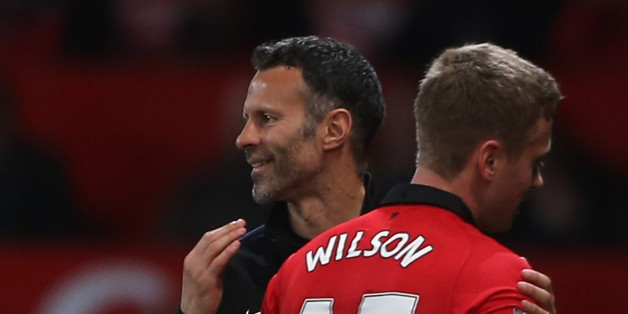 MANCHESTER, ENGLAND - MAY 06:  Interim Manager Ryan Giggs of Manchester United congratulates James Wilson during the Barclays Premier League match between Manchester United and Hull City at Old Trafford on May 6, 2014 in Manchester, England.  (Photo by John Peters/Man Utd via Getty Images)