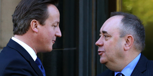 Embargoed to 0001 Sunday January 5.File photo dated 15/10/12 of Prime Minister David Cameron with Scotland's First Minister Alex Salmond (right) as Cameron has come under renewed pressure for a public debate with Salmond following his New Year anti-independence message and a new SNP poll which suggests a substantial number of British people want to see them go head-to-head on television.