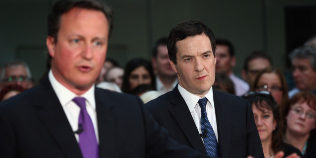 RICKMANSWORTH, ENGLAND - APRIL 22:  British Prime Minister David Cameron and British Chancellor George Osborne speak together during a question and answer session at the construction company Skanska on April 22, 2014 in Rickmansworth, England. The Prime Minister and Chancellor who  usually avoid joint appearances spoke to employees following the announcement that 200 infrastructure projects are due to be completed in 2014-15, which the government claim will support more than 150,000 construction