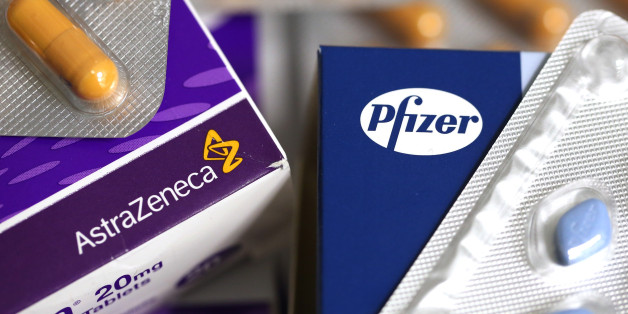 The Pfizer Inc. company logo, right, and the AstraZeneca Plc company logo, are seen on boxes of pharmaceutical products produced by the drug makers in this arranged photograph taken in London, U.K., on Friday, May 2, 2014. AstraZeneca Plc rejected Pfizer Inc.'s sweetened takeover proposal, saying the 63.1 billion-pound ($106.5 billion) offer fails to recognize the value of the promising experimental medicines under development by the U.K.'s second-biggest drugmaker. Photographer: Chris Ratcliffe