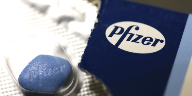 The Pfizer Inc. company logo is seen on packaging for Viagra tablets, produced by Pfizer Inc., in this arranged photograph taken in London, U.K., on Friday, May 2, 2014. AstraZeneca Plc rejected Pfizer Inc.'s sweetened takeover proposal, saying the 63.1 billion-pound ($106.5 billion) offer fails to recognize the value of the promising experimental medicines under development by the U.K.'s second-biggest drugmaker. Photographer: Chris Ratcliffe/Bloomberg via Getty Images