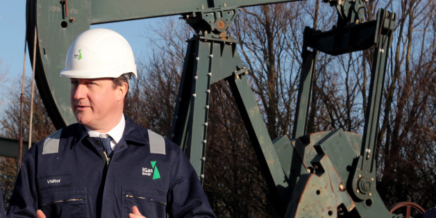 Prime Minister David Cameron looks on during a guided tour of the IGas shale drilling plant oil depot near Gainsborough, Lincolnshire.