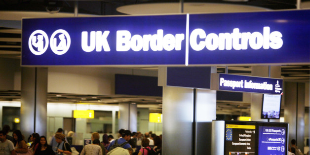 Border Control in Terminal Five of London's Heathrow Airport where some immigration and customs staff have joined a day of strikes by teachers, civil servants and other workers over Government plans to change their pensions, cut jobs and freeze pay.