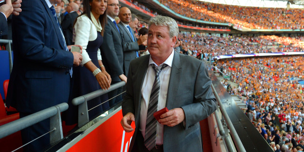 LONDON, ENGLAND - MAY 17:  Steve Bruce, manager of Hull City looks after reciving his runner-up medal after the FA Cup with Budweiser Final match between Arsenal and Hull City at Wembley Stadium on May 17, 2014 in London, England.  (Photo by Michael Regan - The FA/The FA via Getty Images)
