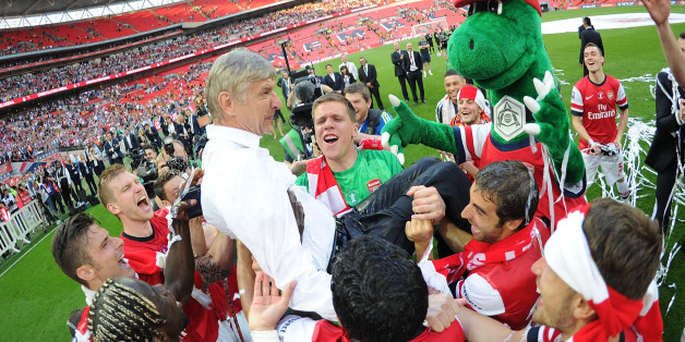 LONDON, ENGLAND - MAY 17:  Thje Arsenal squad throw manager Arsene Wenger in the air after the FA Cup Final between Arsenal and Hull City at Wembley Stadium on May 17, 2014 in London, England.  (Photo by Stuart MacFarlane/Arsenal FC via Getty Images)