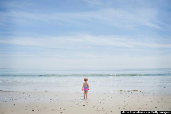 baby at shoreline
