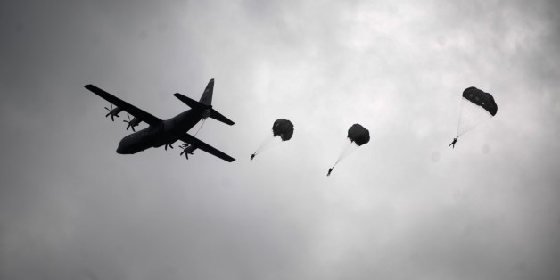A US army soldiers of the second Squadron 28th Cavalry Regiment (2-38th) part of the NATO-led peacekeeping mission in Kosovo jump with parachutes during a US military drill near the town of Gjakova on May 12, 2014. AFP PHOTO / ARMEND NIMANI        (Photo credit should read ARMEND NIMANI/AFP/Getty Images)