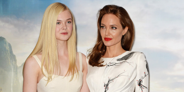 LONDON, ENGLAND - MAY 09:  (EMBARGOED FOR PUBLICATION IN UK TABLOID NEWSPAPERS UNTIL 48 HOURS AFTER CREATE DATE AND TIME. MANDATORY CREDIT PHOTO BY DAVE M. BENETT/WIREIMAGE REQUIRED)  Elle Fanning (L) and Angelina Jolie pose at a photocall for 'Maleficent' at the Corinthia Hotel London on May 9, 2014 in London, England.  (Photo by Dave M. Benett/WireImage)