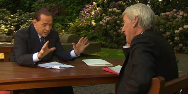 Paxo asks Berlusconi if he called Angela Merkel an 'unfuc*able lard-arse'