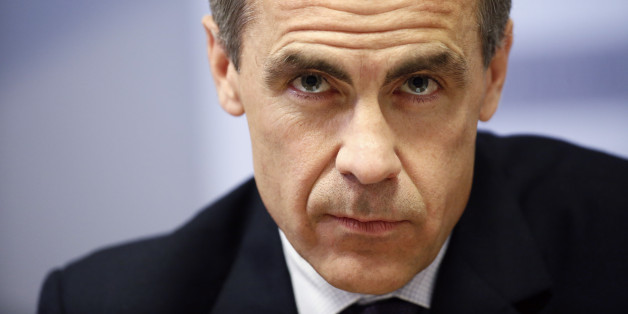 Mark Carney, governor of the Bank of England, pauses during the central bank's quarterly inflation report news conference at the Bank of England in London, U.K., on Wednesday, May 14, 2014. The Bank of England signaled it's willing to wait until next year to raise interest rates even as the U.K. economy strengthens and the amount of spare capacity narrows. Photographer: Simon Dawson/Bloomberg via Getty Images