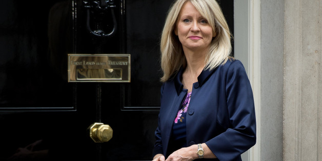 Former Minister for the Disabled Esther McVey poses for pictures outside 10 Downing Street in London, on October 7, 2013. McVey replaces Mark Hoban as Employment Minister as a government reshuffle began Monday. AFP PHOTO/Leon Neal        (Photo credit should read LEON NEAL/AFP/Getty Images)