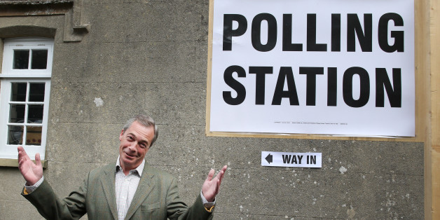 BIGGIN HILL, UNITED KINGDOM - MAY 22:  United Kingdom Independence Party (UKIP) leader Nigel Farage gestures as he arrives at a polling station on May 22, 2014 near Biggin Hill, England.  Millions of voters are going to the polls today in local and European elections.  (Photo by Peter Macdiarmid/Getty Images)