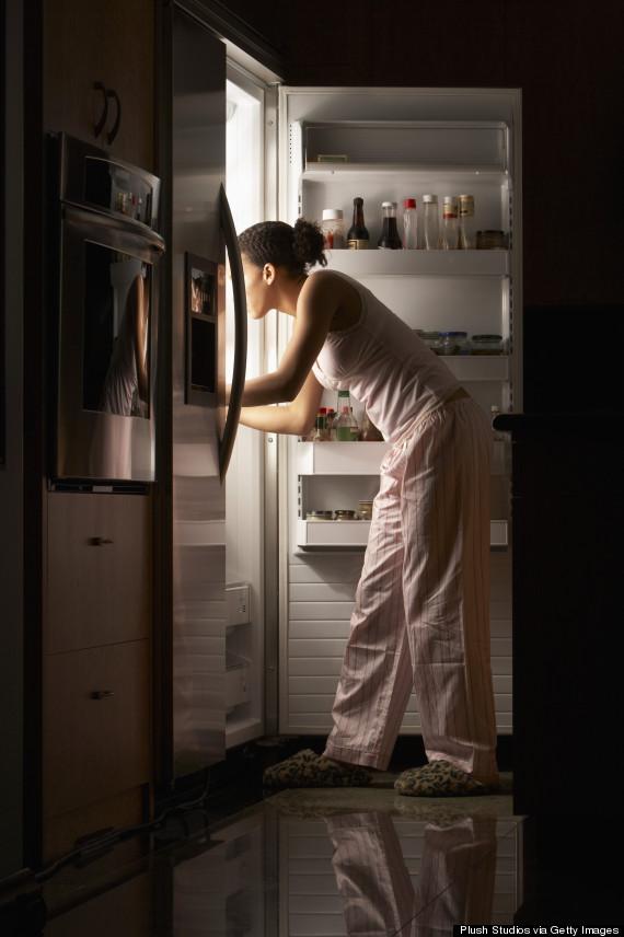 at fridge at night