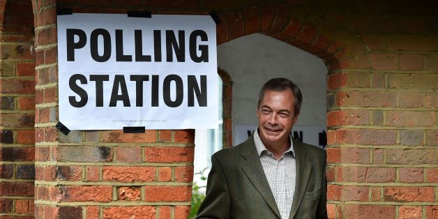United Kingdom Independence Party (UKIP) leader Nigel Farage poses for photographs near Biggin Hill, south of London, before voting in the local and European elections on May 22, 2014. Europe's mammoth parliamentary elections kicked off on Thursday, with Britain and the Netherlands going to the polls in a vote that is expected to see a swing towards populist right-wing parties. The elections, which are spread over four days in the EU's 28 member states, are expected to see major gains for partie