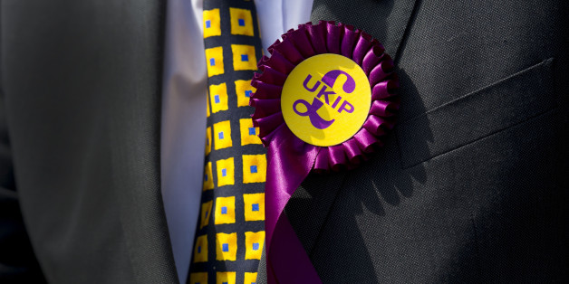 A UKIP supporter wears a rosette during UKIP leader Nigel Farage's visit on April 30, 2014 in Swansea, Wales. The UKIP leader's walkabout in the city centre was cancelled due to security concerns . Nigel Farage visited Swansea as part of the UKIP tour ahead of next month's European elections. (Photo by Matthew Horwood/Getty Images)