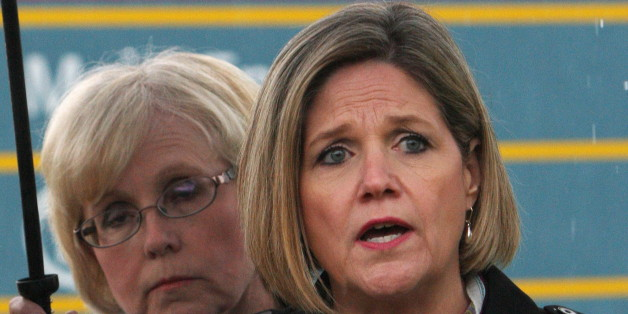 NDP leader Andrea Horwath answers questions as candidate Peggy Sattler looks on in London, Ont., Tuesday, May 20, 2014. Horwath's attempts to make the party more business friendly — and electable — are alienating the party base, which is why some core New Democrats are complaining loudly about her campaign for the June 12 Ontario election, political analysts said. THE CANADIAN PRESS/Dave Chidley