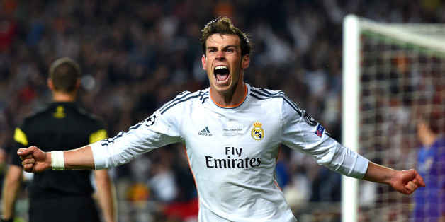 LISBON, PORTUGAL - MAY 24:  Gareth Bale of Real Madrid celebrates scoring their second goal in extra time during the UEFA Champions League Final between Real Madrid and Atletico de Madrid at Estadio da Luz on May 24, 2014 in Lisbon, Portugal.  (Photo by Shaun Botterill/Getty Images)