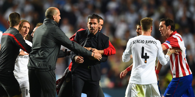 LISBON, PORTUGAL - MAY 24:  Diego Simeone, Coach of Club Atletico de Madrid is restrained as he clashes with Sergio Ramos of Real Madrid  during the UEFA Champions League Final between Real Madrid and Atletico de Madrid at Estadio da Luz on May 24, 2014 in Lisbon, Portugal.  (Photo by Laurence Griffiths/Getty Images)