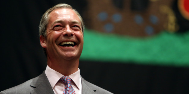 UK Independence Party leader Nigel Farage smiles as he hears the results during the European Parliamentary elections count at the Guildhall in Southampton, Hampshire.