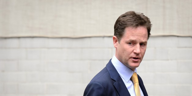 Liberal Democrat party leader Nick Clegg leaves the party headquarters in Westminster, central London, on May 26, 2014. The eurosceptic UK Independence Party (UKIP) of Nigel Farage topped the poll in European elections in Britain, ratcheting up the debate on British membership of the EU.  AFP PHOTO/Leon Neal        (Photo credit should read LEON NEAL/AFP/Getty Images)