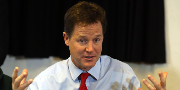 Deputy Prime Minister Nick Clegg talks to youngsters as he helps to launch a scheme to give 16 and 17-year-olds access to work coaches to help them find jobs and training at St Andrews Youth Club, in central London.