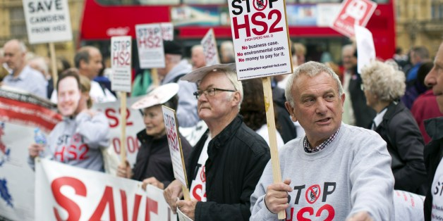 Protesters demonstrate against the government's proposed High Speed 2 (HS2) rail line outside the Houses of Parliament in London on April 28, 2014, as the plans get debated in the House of Commons. Construction of the first stage of the HS2 project, linking London to Birmingham, is proposed to begin in 2017, with the second phase of the scheme then going north to Manchester and Leeds. The full HS2 link between London, the Midlands and the North of England is expected to cost £42.6 billion, wh