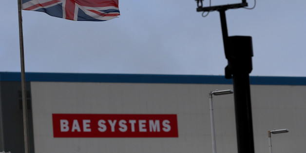 PORTSMOUTH, SCOTLAND - NOVEMBER 06:  A Union Jack flag flies above the BAE systems yard at the HM Naval Base in Portsmouth dockyard following the announcement that the company will be cutting jobs on November 6, 2013 in Portsmouth, England. The cuts are being made following a decline in orders, with 1775 jobs going between the yards in Scotland and England with the end of shipbuilding altogether at the Portsmouth yard.  (Photo by Matt Cardy/Getty Images)