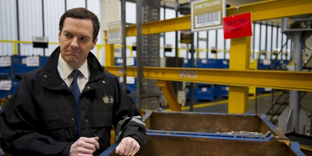 Britain's Chancellor of the Exchequer George Osborne holds freshly minted coins during a visit to the Royal Mint in Llantrisant, Wales on March 25, 2014.  In events surrounding the Chancellor's recent budget, a new design was revealed for a 12-sided one pound coin, designed to be much harder to fake and based on the pre-decimal 'threepenny bit' three pence piece.   AFP PHOTO/POOL/Matthew Horwood        (Photo credit should read MATTHEW HORWOOD/AFP/Getty Images)