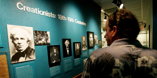 SANTEE, CA - AUGUST 10:  A visitor checks out a display of creationists at the Museum of Creation and Earth History August 10, 2005 in Santee, California. The museum contains exhibits that depict the story of Creationism and refute the theory of Evolution.  (Photo by Sandy Huffaker/Getty Images)