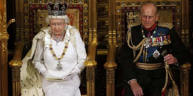 Britain's Queen Elizabeth sits with Prince Philip as she delivers her speech in the House of Lords, during the State Opening of Parliament at the Palace of Westminster in London  June 4, 2014.   REUTERS/Suzanne Plunkett    (BRITAIN - Tags: ENTERTAINMENT POLITICS SOCIETY ROYALS TPX IMAGES OF THE DAY)