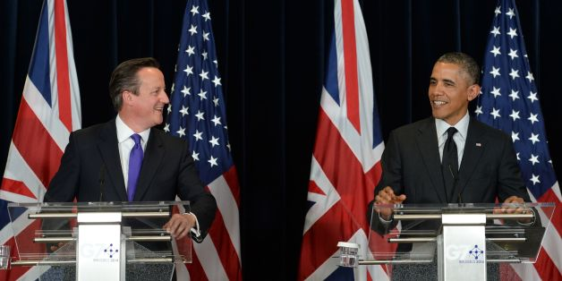 British Prime Minister David Cameron (left) holds a press conference with US President Barack Obama during the G7 Summit held at the EU headquarters in Brussels, Belgium.