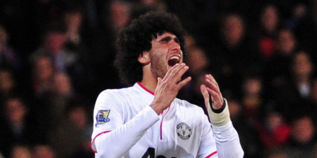 Manchester United's Belgian midfielder Marouane Fellaini reacts after missing a chance during the English Premier League football match between Crystal Palace and Manchester United at Selhurst Park in south London on February 22, 2014. AFP PHOTO / CARL COURTRESTRICTED TO EDITORIAL USE. No use with unauthorized audio, video, data, fixture lists, club/league logos or live services. Online in-match use limited to 45 images, no video emulation. No use in betting, games or single club/league/player p