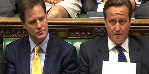 Deputy Prime Minister Nick Clegg and Prime Minister David Cameron listen as leader of the opposition Ed Miliband speaks during a debate on the Queen's Speech in the House of Commons, London.