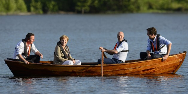 (L to R) British Prime Minister David Cameron, German Chancellor Angela Merkel, Swedish Prime minister Fredrik Reinfeldt and Dutch Prime Minister Mark Rutte talk in a boat near the summer residence of the Swedish Prime Minister in Harpsund 120km west of Stockholm on June 9, 2014. The Swedish Prime Minister will host German Chancellor Angela Merkel, British Prime Minister David Cameron and Dutch Prime Minister Mark Rutte for talks on the EU and the new European Parliament on June 9 to 10, 2014. A